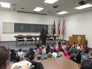 Claudia Williams speaking to the children about safety and being good.